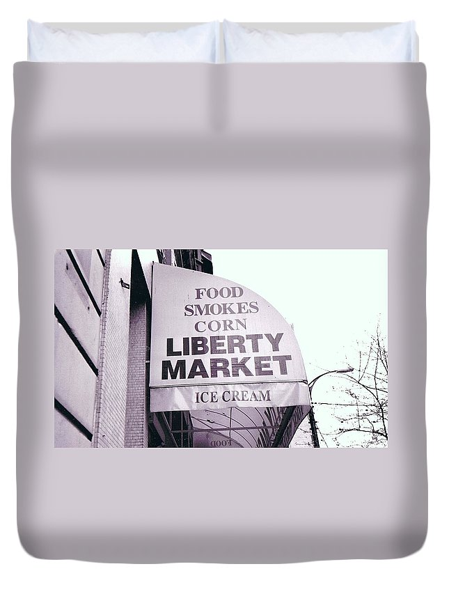 City Duvet Cover featuring the photograph East Side Awning by Chris Colibaba