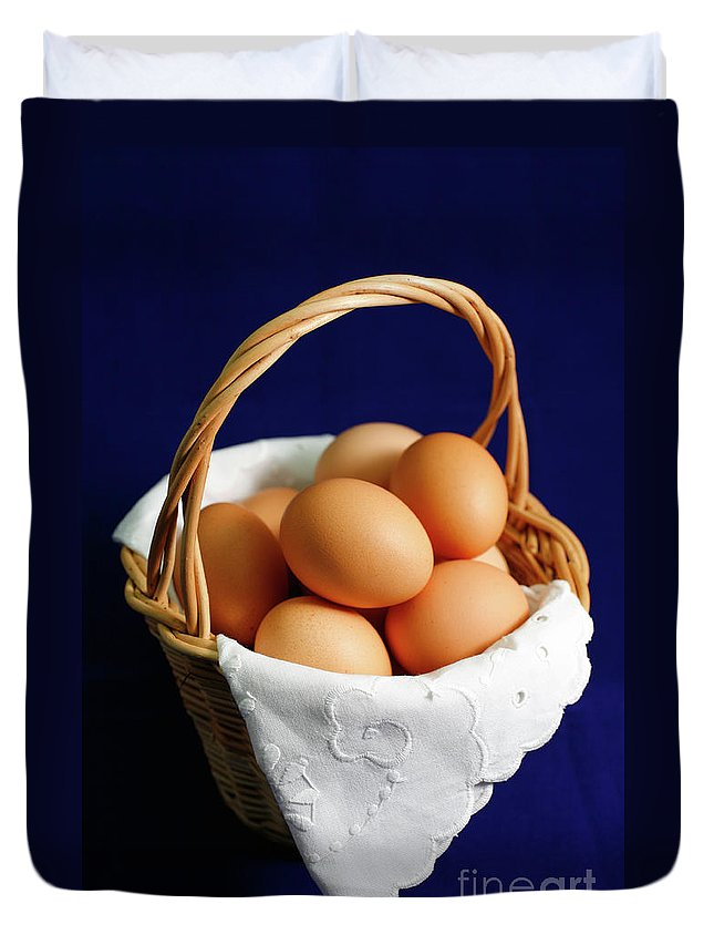 Eggs Duvet Cover featuring the photograph Eggs In A Wicker Basket. by Gaspar Avila
