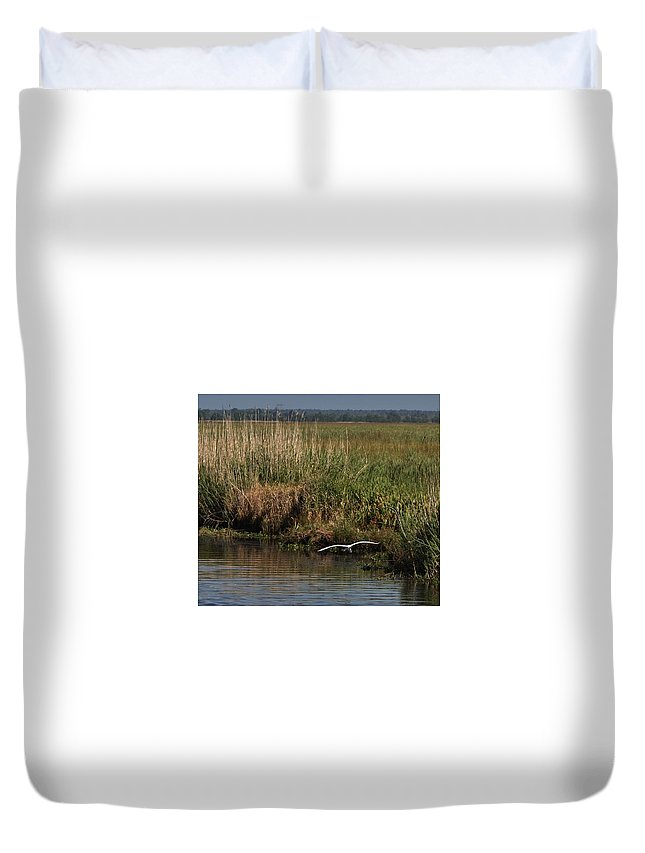 Egret Flying On The Bayou Duvet Cover featuring the photograph Egret On The Bayou by Kathy Kirkland