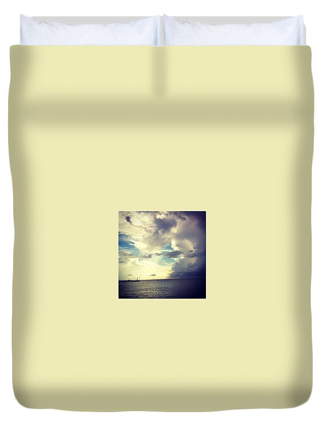 Ocean Clouds Duvet Cover featuring the photograph End Of The World. by Sasha Kay