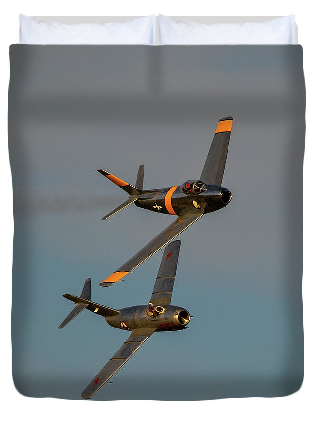 North American F-86 Sabre And Mikoyan-gurevich Mig-15 Duvet Cover featuring the photograph F-86 And Mig-15 by Tommy Anderson