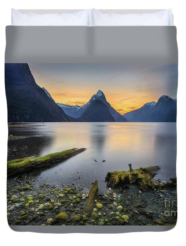 Sunset Duvet Cover featuring the photograph Fallen Logs Milford Sound by Kamrul Arifin Mansor