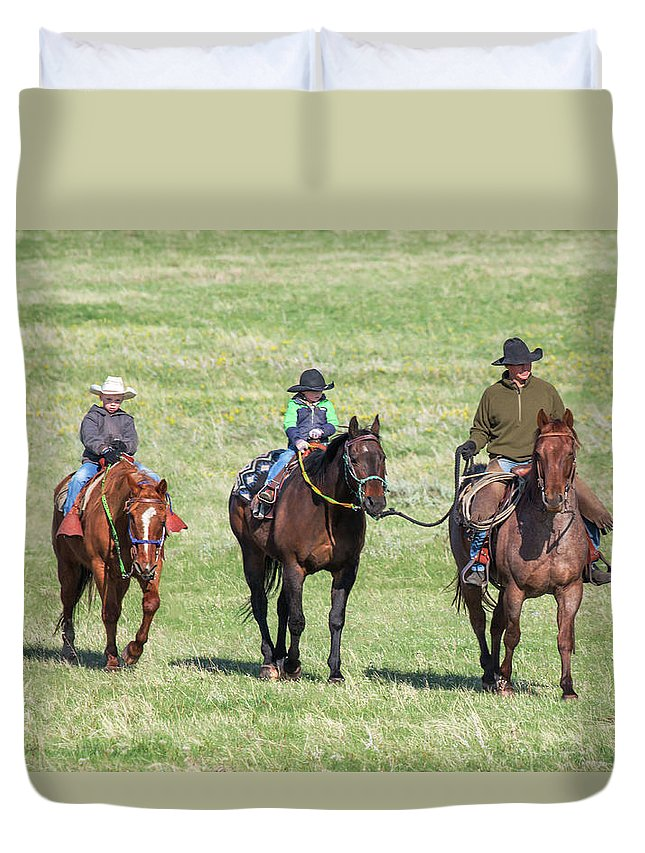 A Cowboy Father Leads His Sons On Horseback To Help Roundup Cattle On A Ranch In Montana. Duvet Cover featuring the photograph Father And Sons by Todd Klassy
