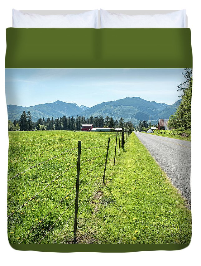 Fenced In Dandelions Duvet Cover featuring the photograph Fenced In Dandelions by Tom Cochran