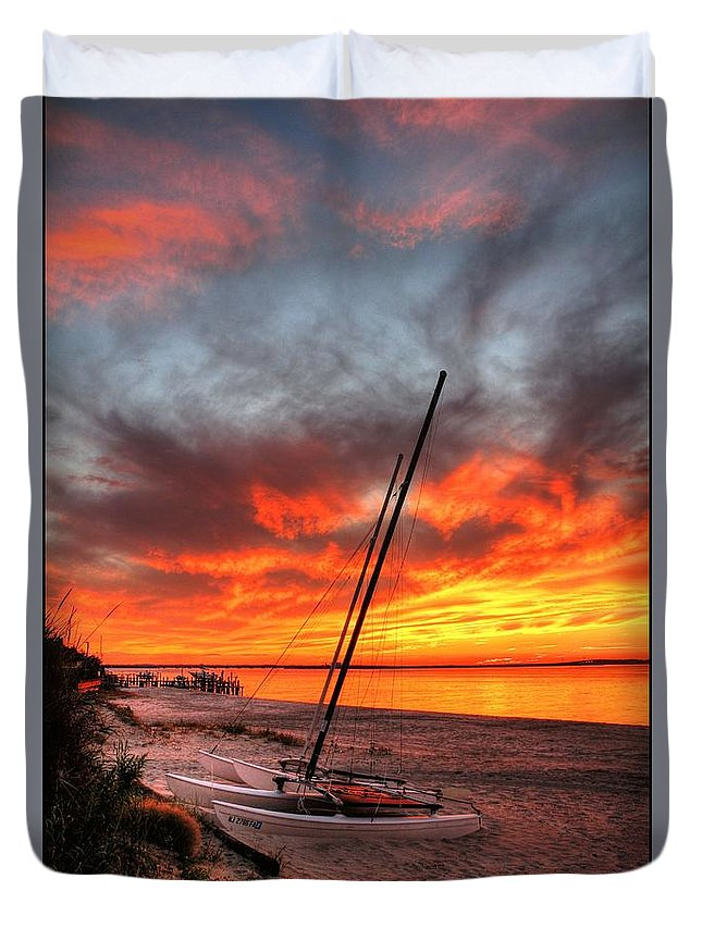 Sunset Duvet Cover featuring the photograph Fiery Sunset by John Loreaux