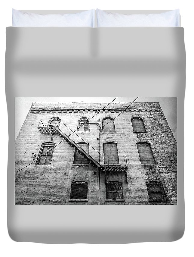 Architecture Duvet Cover featuring the photograph Fire Escape by Jim Love