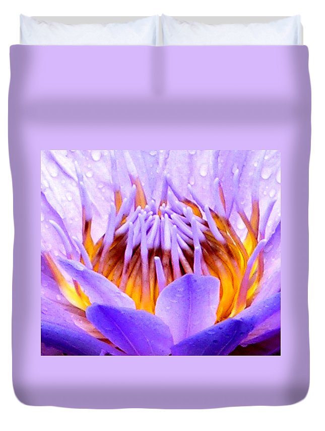 Purple Water Lily Duvet Cover featuring the photograph Fire In The Lily by John Lautermilch