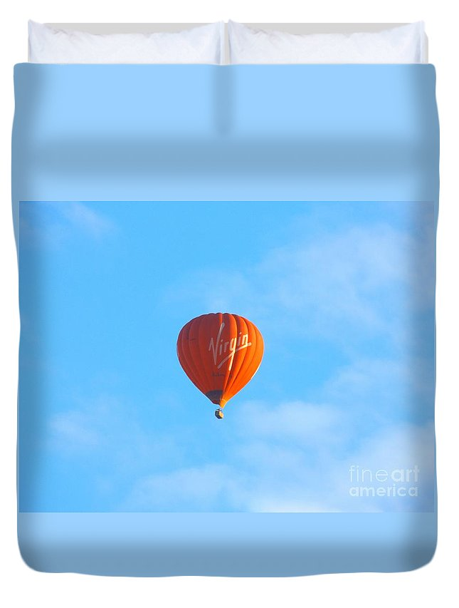 Hot Duvet Cover featuring the photograph Floating Away by Justin Farrimond