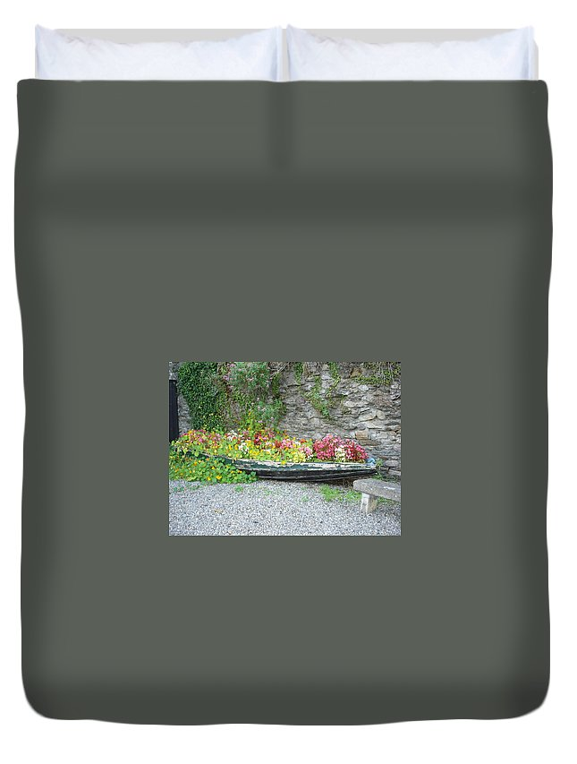 Inistioge Duvet Cover featuring the photograph Flowers Floating by Kelly Mezzapelle
