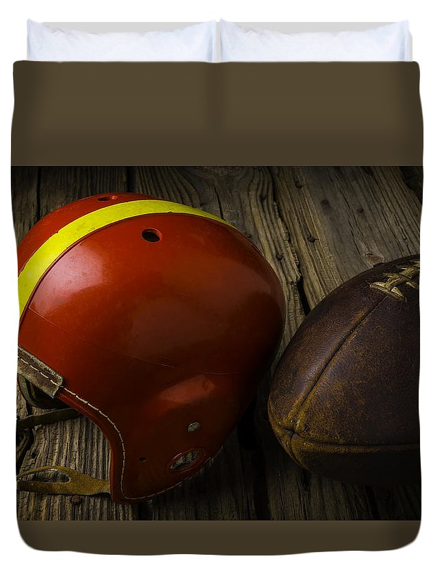 Red Duvet Cover featuring the photograph Football Helmet And Football by Garry Gay