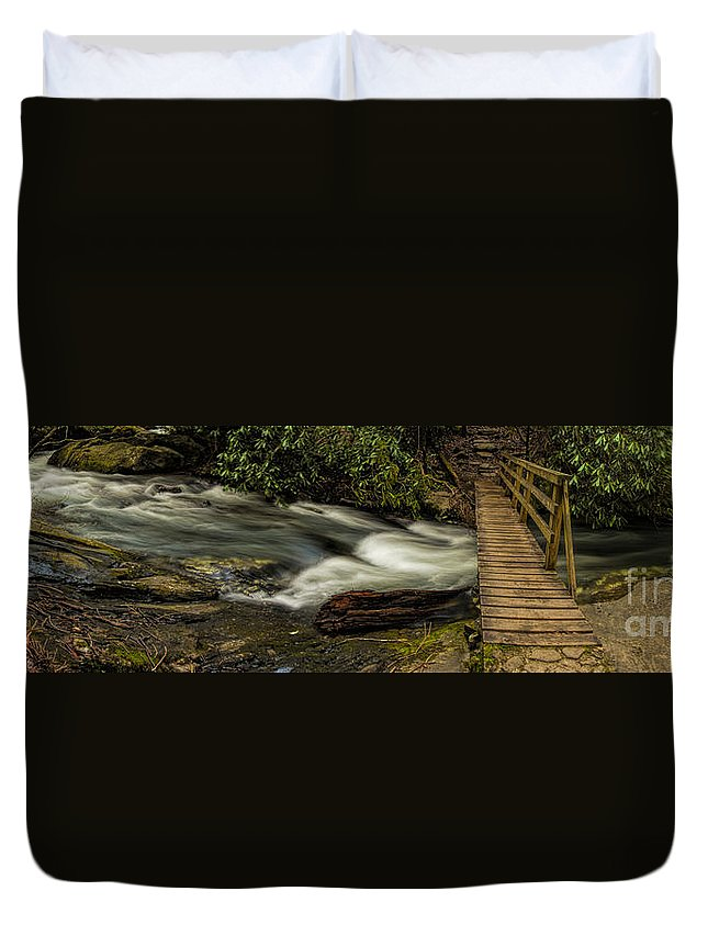Footbridge Duvet Cover featuring the photograph Footbridge Over Raging Moccasin Creek by Barbara Bowen