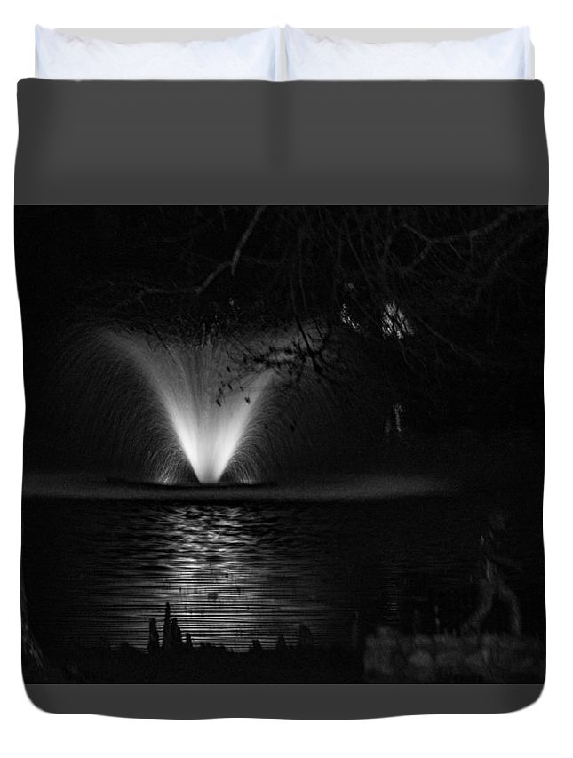 Night Duvet Cover featuring the photograph Fountain At Swan Lake by Alicia Collins