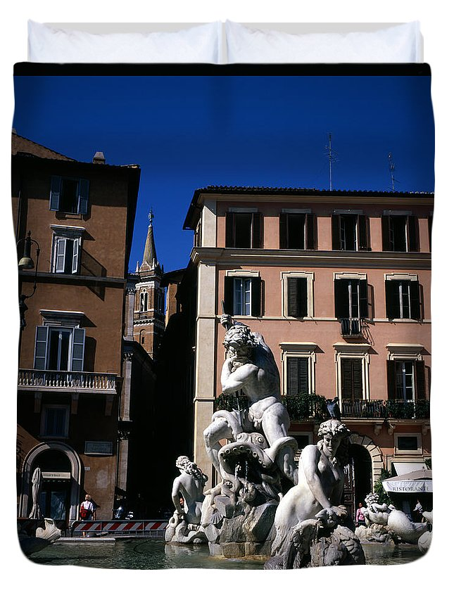 Piazza Navona Fountain Neptune Rome Fountains Statue Statues Duvet Cover featuring the photograph Fountain Depicting Neptune The Piazza Navona The Spire Of The Church Of Santa Maria Della Pace Rome by Michael Walters