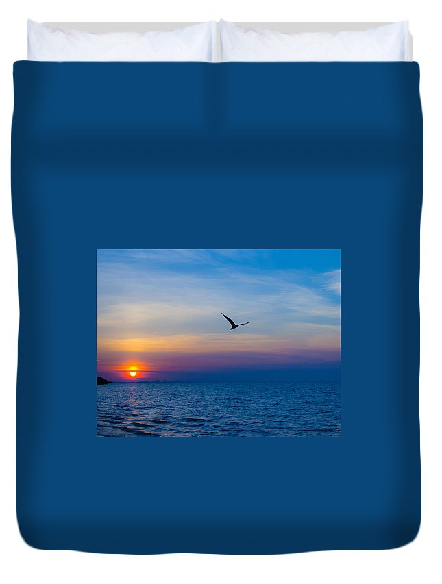 Tampa Sunrise Duvet Cover featuring the photograph Free by Rob Craig