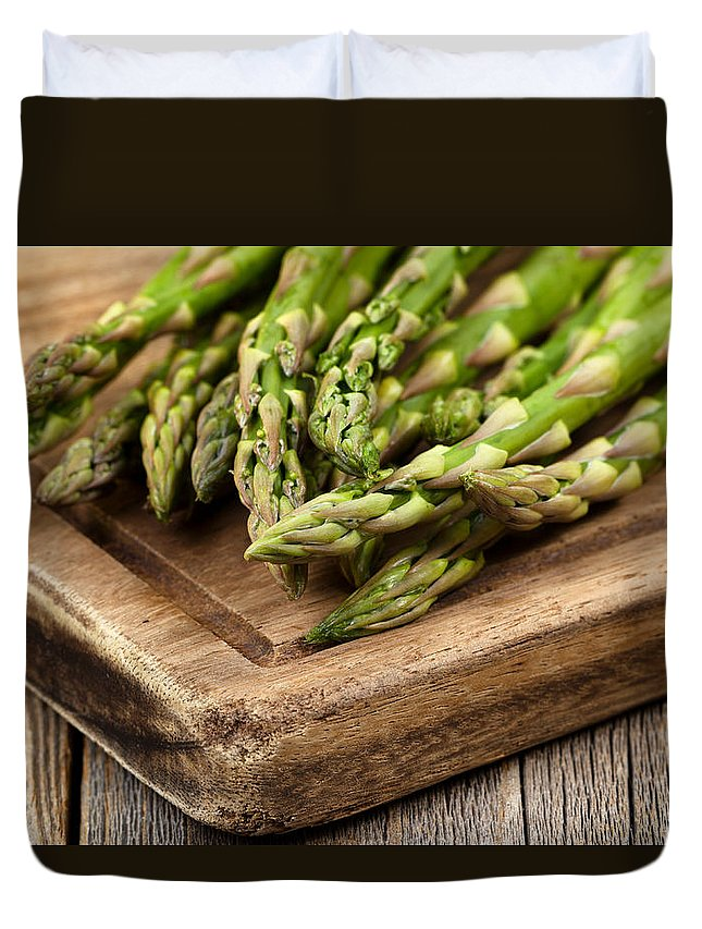 Asparagus Duvet Cover featuring the photograph Fresh Asparagus On Rustic Wooden Server Board by Thomas Baker