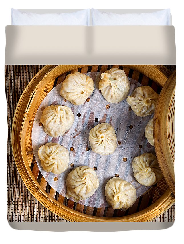 Chinese Duvet Cover featuring the photograph Freshly Cooked Dumplings Inside Of Bamboo Steamer Ready To Eat by Thomas Baker