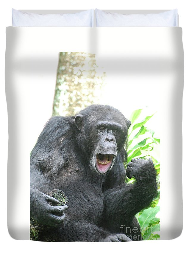 funny chimp making faces with his mouth and lips duvet cover for