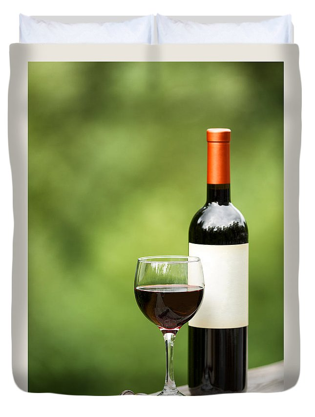 Wine Duvet Cover featuring the photograph Glass Of Red Wine Outdoors Ready To Enjoy by Thomas Baker