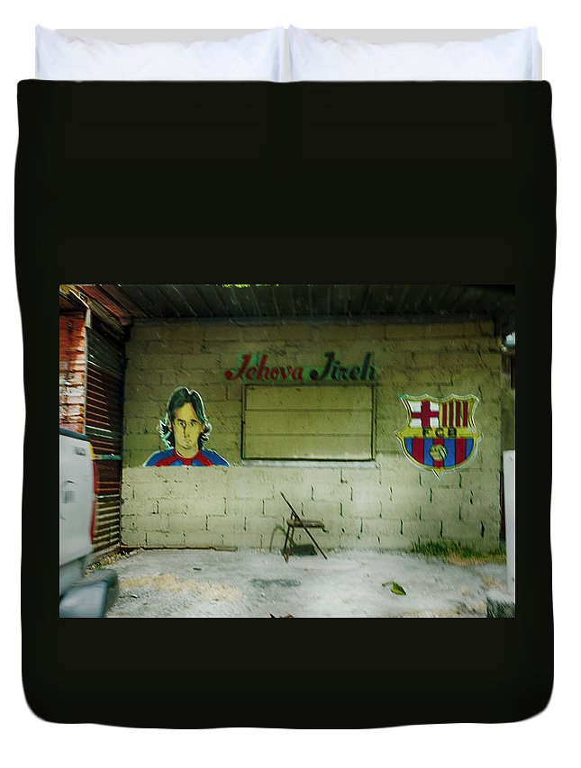 Chorillo Duvet Cover featuring the photograph God And Futbol by Jessica Levant