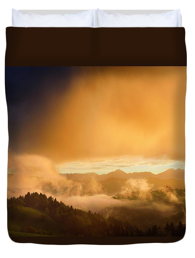 Golden Duvet Cover featuring the photograph Golden Clouds And Fog At Sunrise In The Mountains Of Kamnik Savi by Reimar Gaertner
