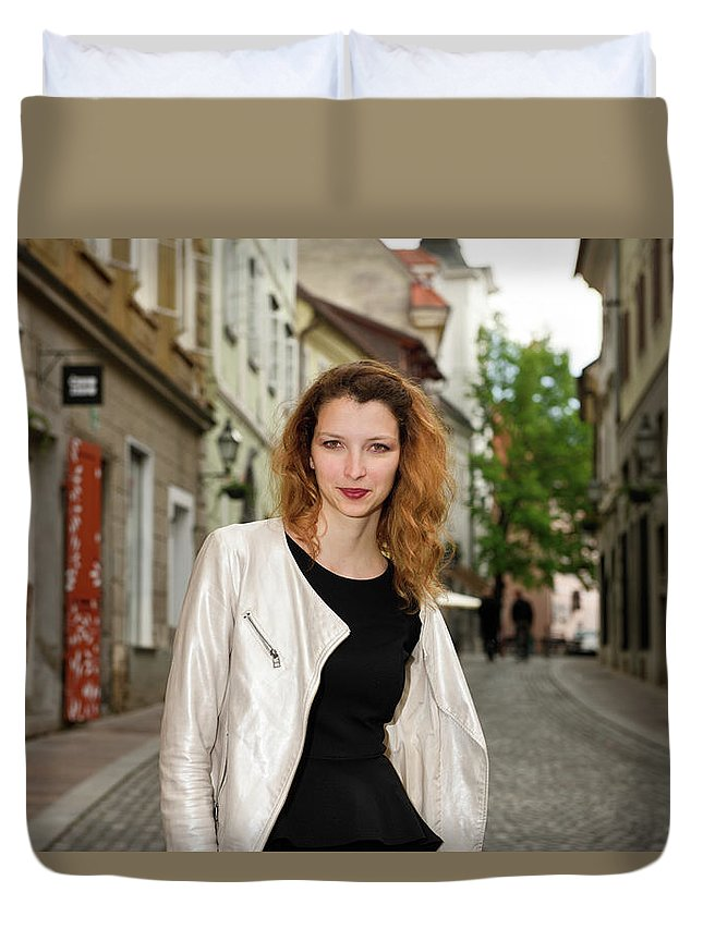 Grin Duvet Cover featuring the photograph Grinning Attractive Woman Standing On Cobblestone Street Of Uppe by Reimar Gaertner