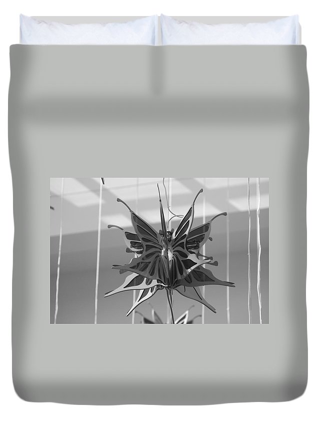 Black And White Duvet Cover featuring the photograph Hanging Butterfly by Rob Hans