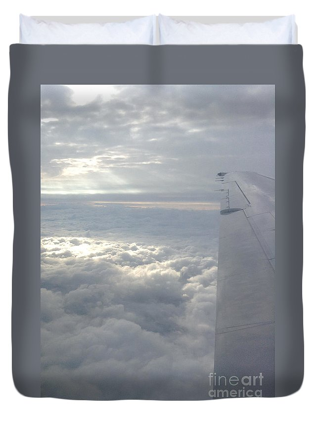 Airplane Duvet Cover featuring the photograph High Above The Clouds by Gina Sullivan