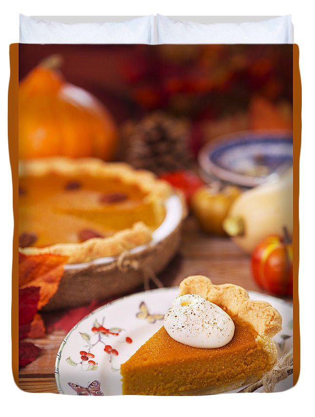 Pumpkin Pie Duvet Cover featuring the photograph Homemade Pumpkin Pie On A Rustic Table With Autumn Decorations by Sara Winter