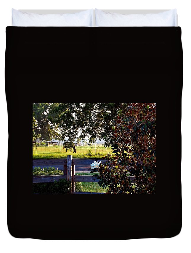 Pelican Duvet Cover featuring the photograph Horse And Flower by Michael Thomas