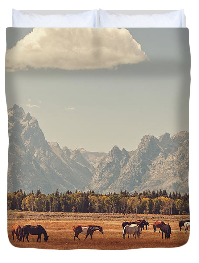 Teton's Duvet Cover featuring the photograph Horses Grazing In Front Of The Teton's by Carolyn Rauh