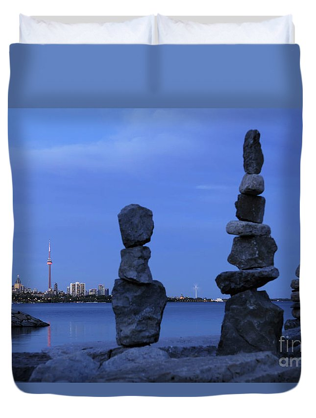 Inukshuk Duvet Cover featuring the photograph Human Figures Made From Stones At Night by Oleksiy Maksymenko