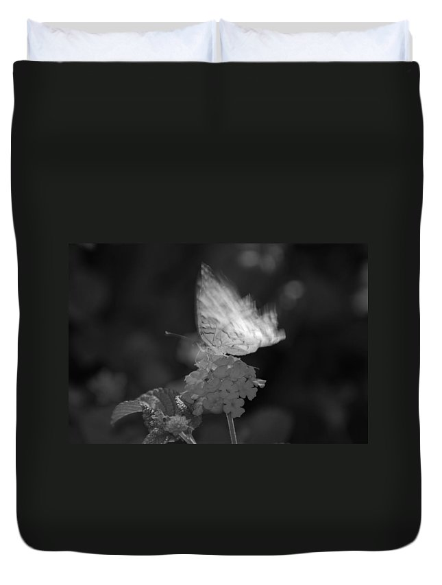 Black And White Duvet Cover featuring the photograph In Motion by Rob Hans