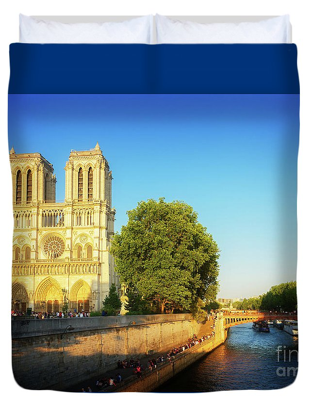 Notre-dame Duvet Cover featuring the photograph Notre Dame In Sunset Light by Anastasy Yarmolovich