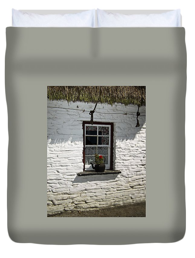 Irish Duvet Cover featuring the photograph Irish Kettle Of Geraniums County Cork Ireland by Teresa Mucha