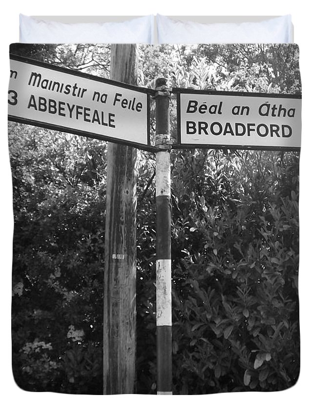 Sign Photography Photo Broadford Ireland Eire Abbeyfeale Signpost Limerick Duvet Cover featuring the photograph Irish Village Sign County Limerick. by Andy Donald