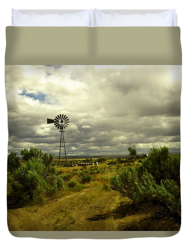 Landscape Duvet Cover featuring the photograph Isolated Windmill by Jeff Swan