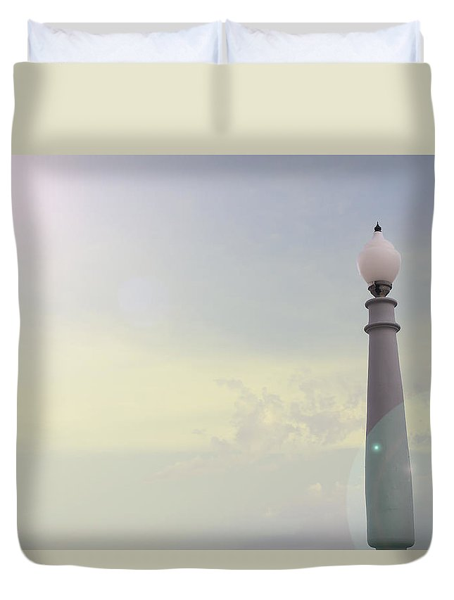 Light Duvet Cover featuring the photograph Lampposts And Sky At Dawn by Jose Luis Agudo