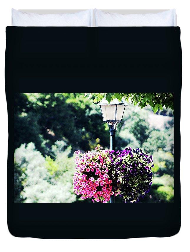 Candeeiro De Rua Duvet Cover featuring the photograph Lighted Flowers by Raquel Daniell