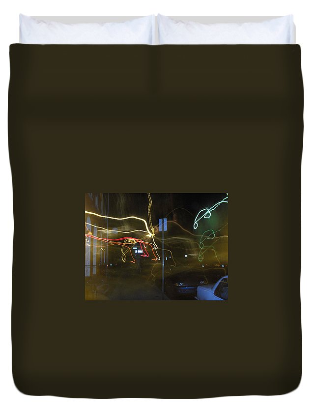 Photograph Duvet Cover featuring the photograph Lights That Attack Cars Two by Thomas Valentine