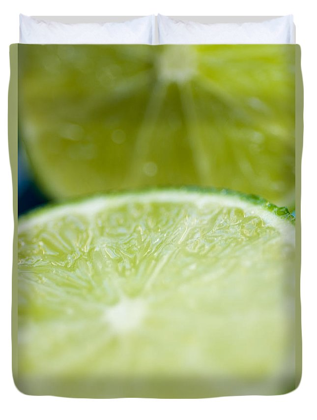 Blur Duvet Cover featuring the photograph Lime Cut by Ray Laskowitz - Printscapes