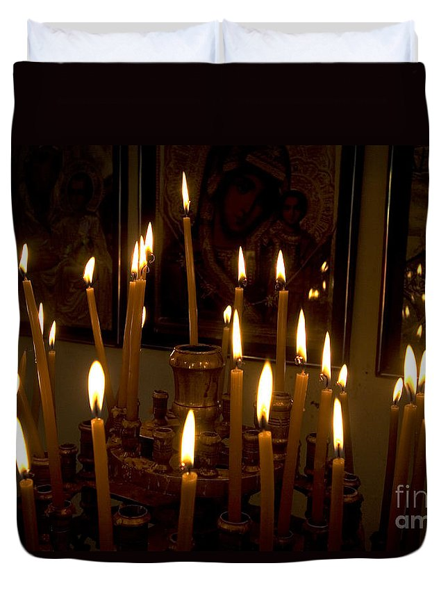 Lit Duvet Cover featuring the photograph lit Candles in church by Danny Yanai