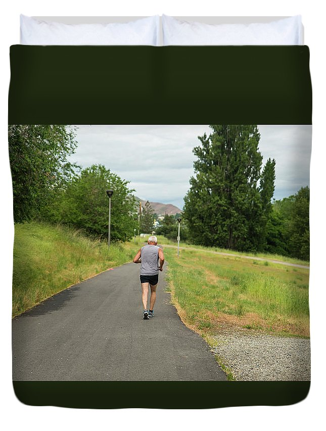 Loop Trail Runner Duvet Cover featuring the photograph Loop Trail Runner by Tom Cochran
