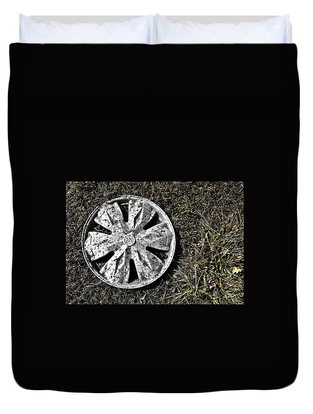 Hub Cap Duvet Cover featuring the photograph Lost Hub Cap by Angus Hooper Iii