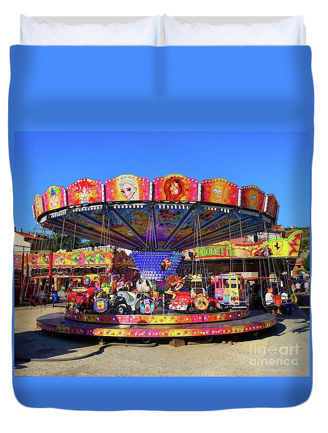 Merry-go-round Duvet Cover featuring the photograph Merry-go-round by Don Pedro DE GRACIA