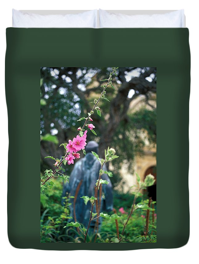 Missions Duvet Cover featuring the photograph Mission Statue And Flower by Kathy Yates