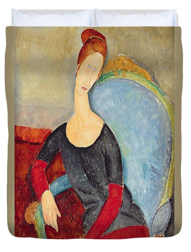 Mme Hebuterne In A Blue Chair Duvet Cover featuring the painting Mme Hebuterne In A Blue Chair by Amedeo Modigliani