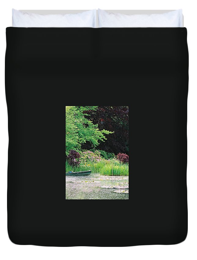 Monet Duvet Cover featuring the photograph Monet's Garden Pond And Boat by Nadine Rippelmeyer