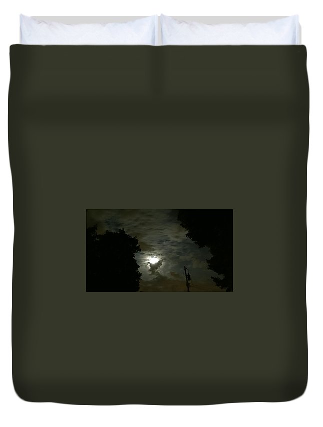 Moon Duvet Cover featuring the photograph Moonlit Strip by Eric Wait