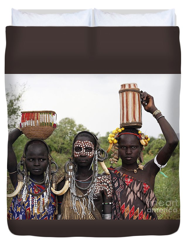 Ethiopia Duvet Cover featuring the photograph Mursi Tribesmen In Ethiopia by Gilad Flesch