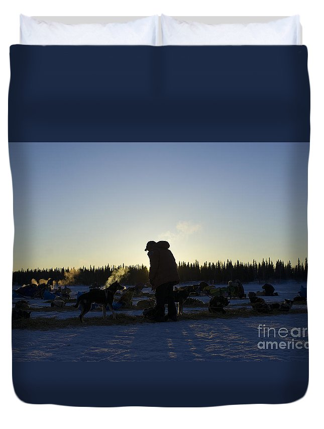 Sunrise Sunset Mushers Sled Dogs Silhouette Cold Winter Iditarod Duvet Cover featuring the photograph Mushers At Sunrise by Chip Laughton